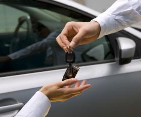 woman receiving car key from man